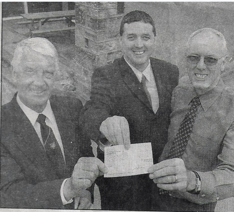 Masons' £1000 gift towards schools new library